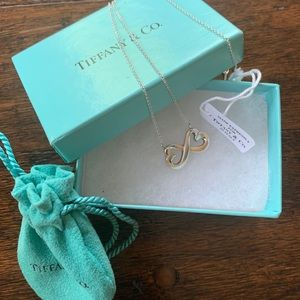 A new 14 carat TIFFANY & CO. Necklace.
